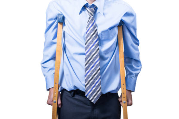 image of businessman on crutches - Jon Correll Attorney LLC provides assistance with workers' compensation